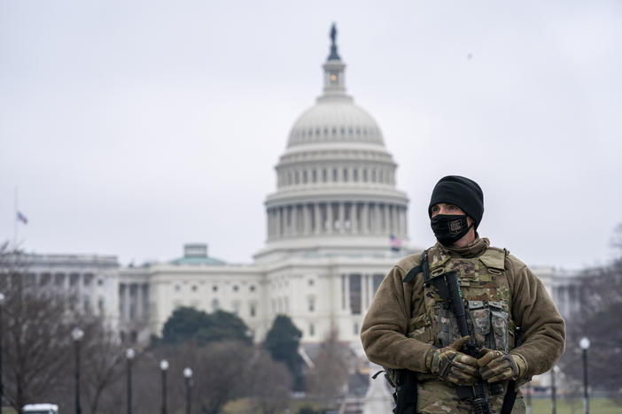 Member of the national guard patrol the area outside of the U.S. Capitol on the third day of the impeachment trial of former President Donald Trump at Capitol Hill, in Washington, Thursday, Feb. 11, 2021.