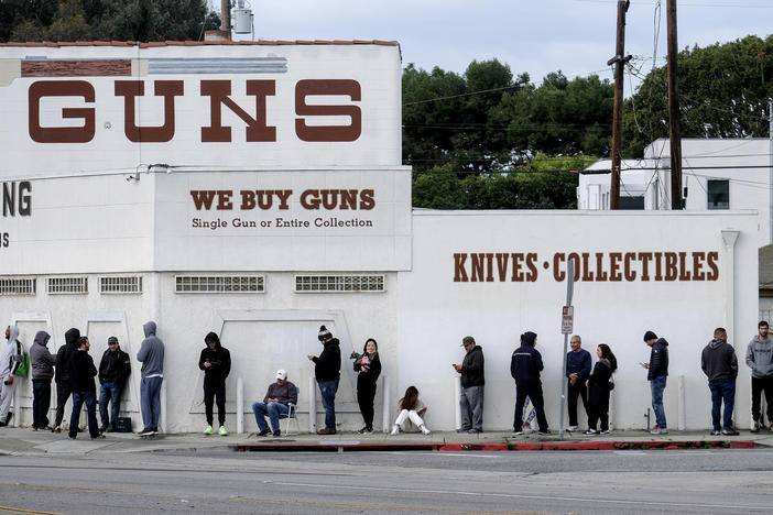 n this March 15, 2020, file photo, people wait in line to enter a gun store in Culver City, Calif