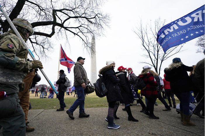 In this Wednesday, Jan. 6, 2021 file photo Trump supporters gather on the Washington Monument grounds in advance of a rally in Washington. Both within and outside the walls of the Capitol, banners and symbols of white supremacy and anti-government extremism were displayed as an insurrectionist mob swarmed the U.S. Capitol.