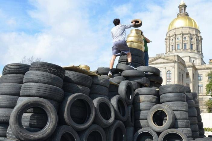 Old tires stacked in front of the Georgia State Capitol