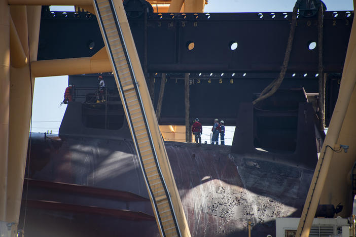 Crews Assess Fire Damage To Capsized Ship Golden Ray