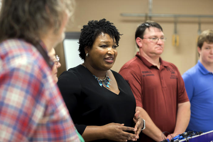 Stacey Abrams speaks to media during a 2018 campaign stop.