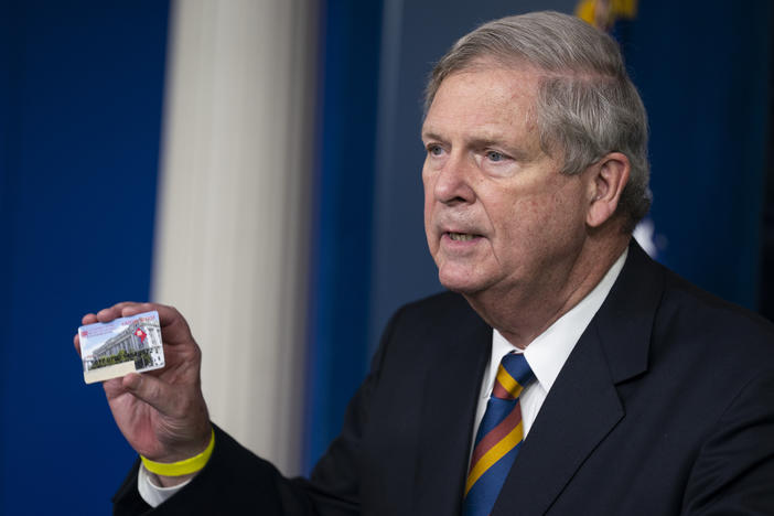 Agriculture Secretary Tom Vilsack holds up a Supplemental Nutrition Assistance Program Electronic Benefits Transfer (SNAP EBT) card during a press briefing at the White House, Wednesday, May 5, 2021, in Washington.