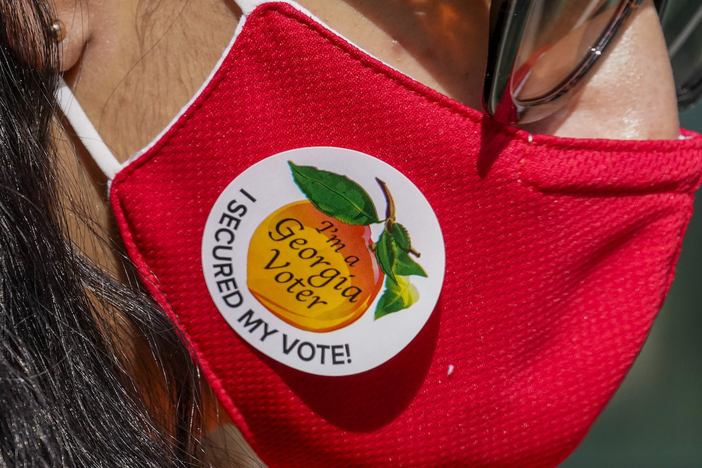"A person wears an ""I'm a Georgia Voter"" sticker after voting on Election Day in Atlanta on Tuesday, Nov. 3, 2020"