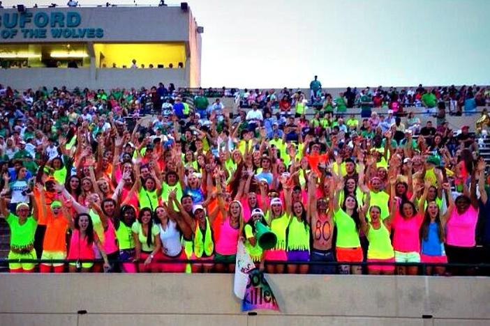 The Buford student section rocked bright neon get-ups as they cheered their Wolves onto a Week One victory against Elbert County