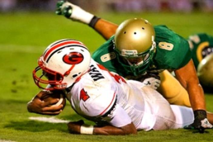 Gainesville Quarterback Deshaun Watson is taken down by a tackle on a carry.