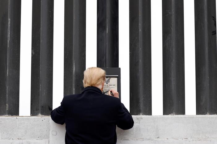 News Wrap: Trump touts border wall in visit to Texas