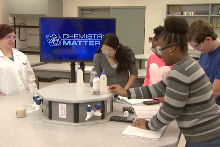 The students perform a rocket combustion lab in this segment.