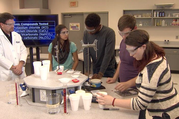 The students perform the coffee cup calorimetry experiment.