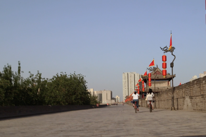 Another sweltering hot day in filming in on the ancient city walls of Xi'an.