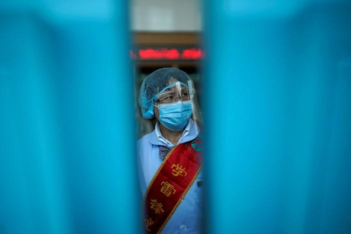 A year after virus appeared, Wuhan tells China's pandemic story