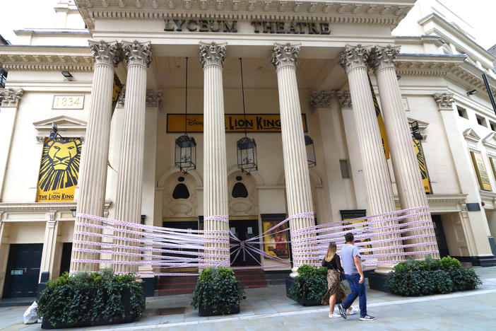 "London's Lyceum Theatre is wrapped in pink tape bearing the words ""Missing Live Theatre,"" part of a campaign by a group of British stage designers."