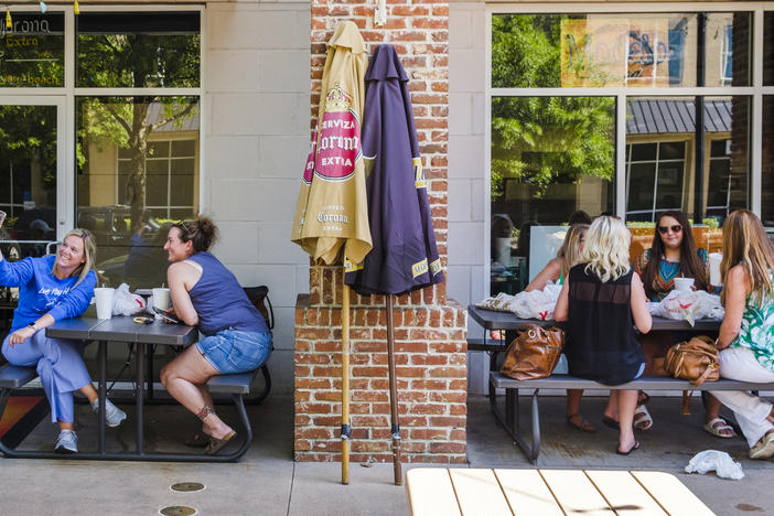 Diners outside a Mexican restaurant near Mercer University in Macon were separated by a brick pillar and a few feet Tuesday.
