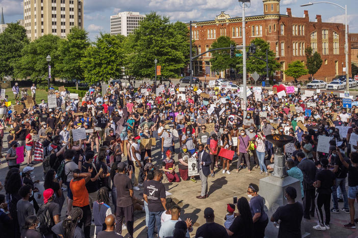 About 800 people marched in protest of police violence in Macon Tuesday.