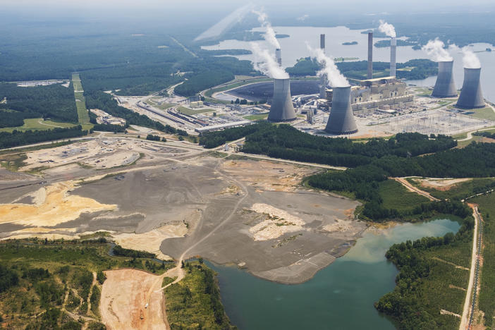 The coal ash pond, foreground, of Georgia Power's Plant Scherer near Juliette in August 2019.