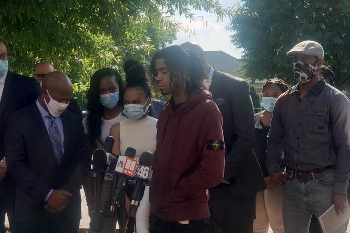 Messiah Young and Teniyah Pilgrim address the media Monday night alongside their families and their attorneys, Mawuli Davis and L. Chris Stewart.