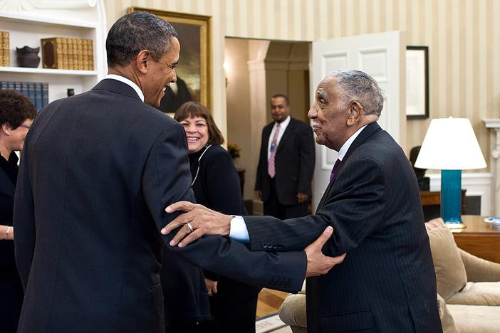 President Barack Obama meets with civil rights movement leader Rev. Dr. Joseph Lowery and his family in the Oval Office, Jan. 18, 2011.