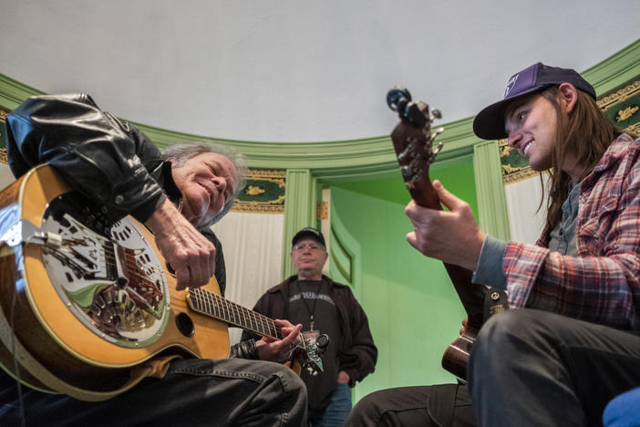 "Tommy Talton, left, and Duane Betts, enjoy working out the guitar parts of the Allman Brothers Band's ""Little Martha"" before soundcheck at the Macon City Auditorium Monday."