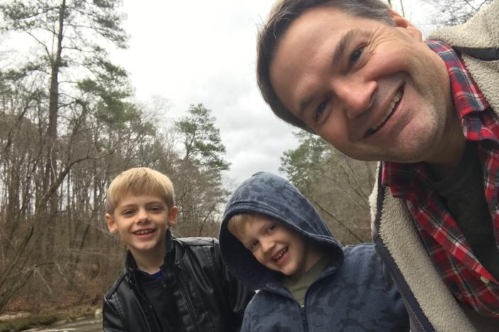 Steve Fennessy with sons Casey (left) and Jack (center).)