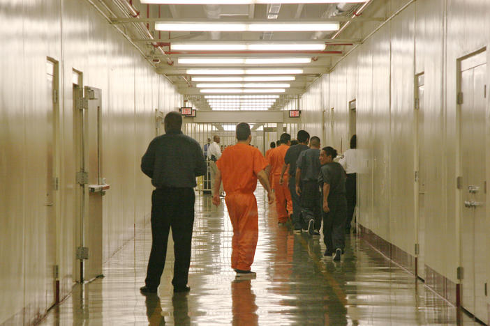 This April 13, 2009 photo shows a detainee at Immigration and Customs Enforcement's Stewart Detention Center in Lumpkin, Ga., leaving the cafeteria after lunch to go back to their living units.