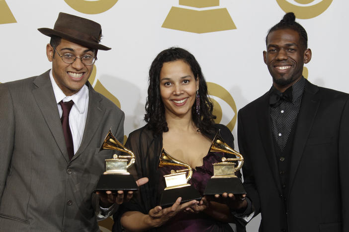 Musicians Dom Flemons, Rhiannon Giddens and Justin Robinson, of the Carolina Chocolate Drops, pose with the award for best traditional folk album at the Grammy Awards. Their music is inspired by the Appalachian region.