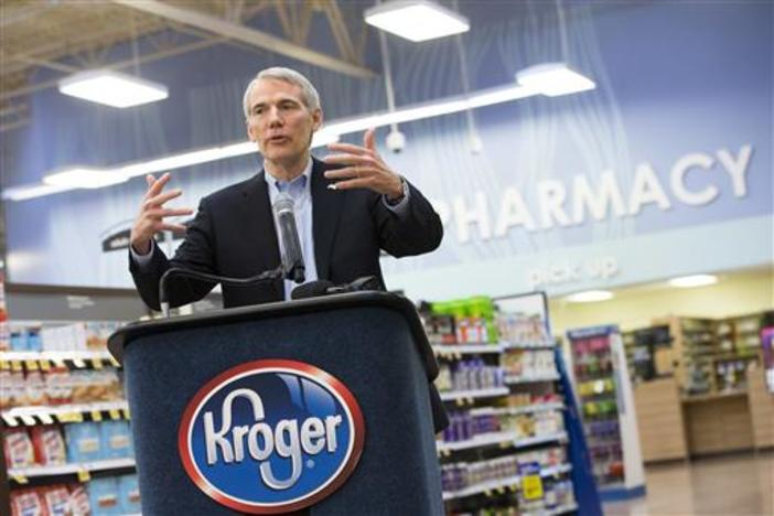 In this Friday, Feb. 12, 2016, photo, Sen. Rob Portman, R-Ohio, speaks during a news conference at the Oakley Kroger Marketplace store, in Cincinnati, to announce the supermarket chain's decision to offer the opioid overdose reversal medicine naloxone.