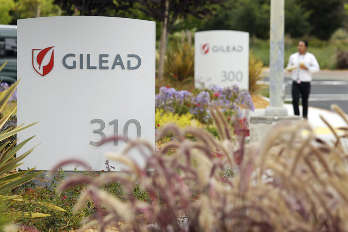 A man walks outside the headquarters of Gilead Sciences in Foster City, Calif. Gilead Sciences Inc.