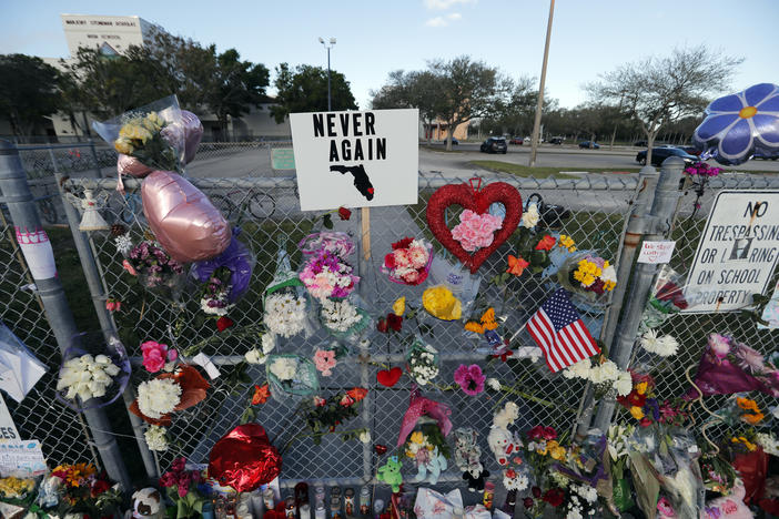 A makeshift memorial is seen outside the Marjory Stoneman Douglas High School, where 17 students and faculty were killed in a mass shooting on Wednesday, in Parkland, Fla.