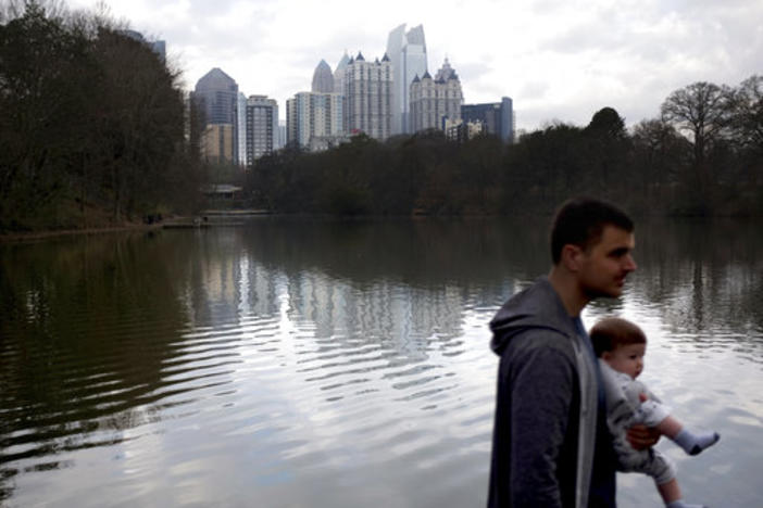 The midtown skyline stands in the background in Piedmont Park in Atlanta.