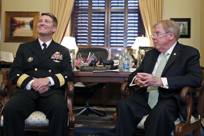 U.S. Navy Rear Adm. Ronny Jackson, M.D., left, sits with Sen. Johnny Isakson, R-Ga., chairman of the Veteran's Affairs Committee, before their meeting on Capitol Hill, Monday, April 16, 2018 in Washington.
