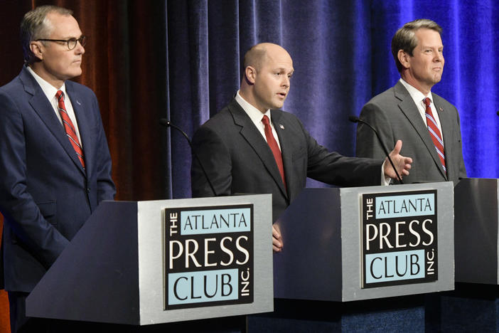 Georgia Republican gubernatorial candidates Casey Cagle, left and Brian Kemp, right, with former candidate Hunter Hill, center, during a debate Thursday, May 17, 2018, in Atlanta.