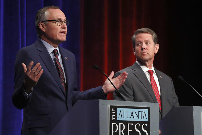 Republican candidates for Georgia Governor Georgia Lt. Gov. Casey Cagle, left, and Secretary of State Brian Kemp speak during an Atlanta Press Club debate at Georgia Public Television Thursday, July 12, 2018, in Atlanta.