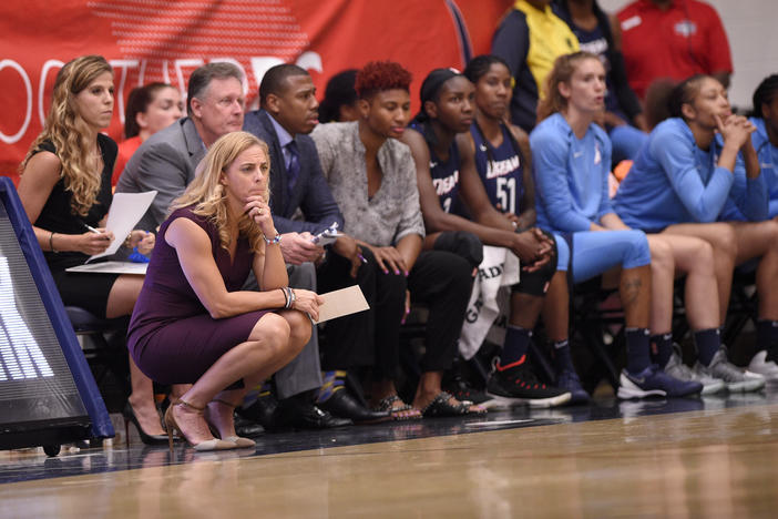 Atlanta Dream head coach Nicki Collen, left, watches during the first half of Game 3 of a WNBA semifinals basketball playoff game against the Washington Mystics, Friday, Aug. 31, 2018, in Washington.