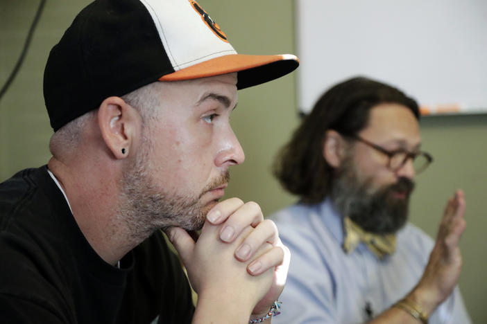 In this Oct. 8, 2018, photo, Tim Nolen, left, participates in a relapse prevention group session with counselor Bob Benson, right, at a treatment facility run by Buffalo Valley Inc. in Nashville, Tenn.