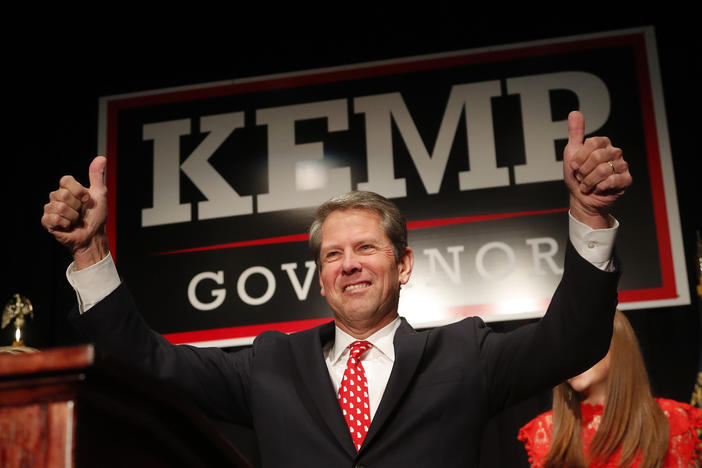 Brian Kemp gives a thumbs-up to supporters, Wednesday, Nov. 7, 2018, in Athens, Ga.
