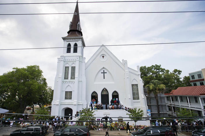 In this June 25, 2015, file photo, people line up to attend the wake of Sen. Clementa Pinckney, one of the nine killed in a shooting, at Emanuel AME Church in Charleston, S.C.