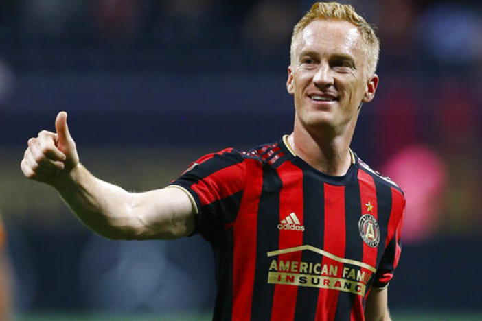 Atlanta United midfielder Jeff Larentowicz gestures to the crowd after the team's MLS soccer match against Toronto FC in Atlanta on Wednesday, May 8, 2019.