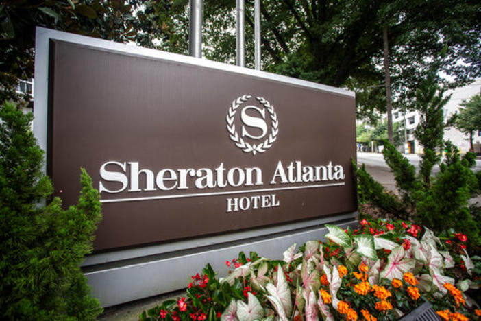 The sign at the entrance to the Sheraton Atlanta Hotel is seen on Wednesday, July 31, 2019, in Atlanta. The hotel was shut down voluntarily in July of 2019 after three guests tested positive for Legionnaires' disease.
