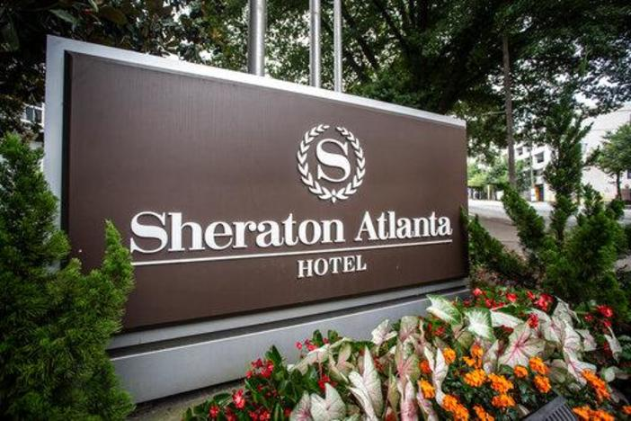 The sign at the entrance to the Sheraton Atlanta Hotel is seen on Wednesday, July 31, 2019, in Atlanta, Georgia. The hotel was shut down voluntarily in July of 2019 after three guests tested positive for Legionnaires' disease.