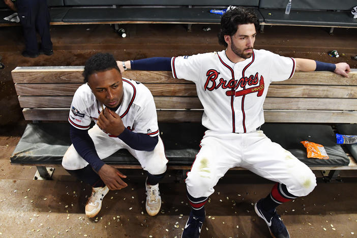 Atlanta Braves' Dansby Swanson, right, and Ozzie Albies sit in the dugout after the Braves lost 13-1 to the St. Louis Cardinals in Game 5 of their National League Division Series on Wednesday in Atlanta.