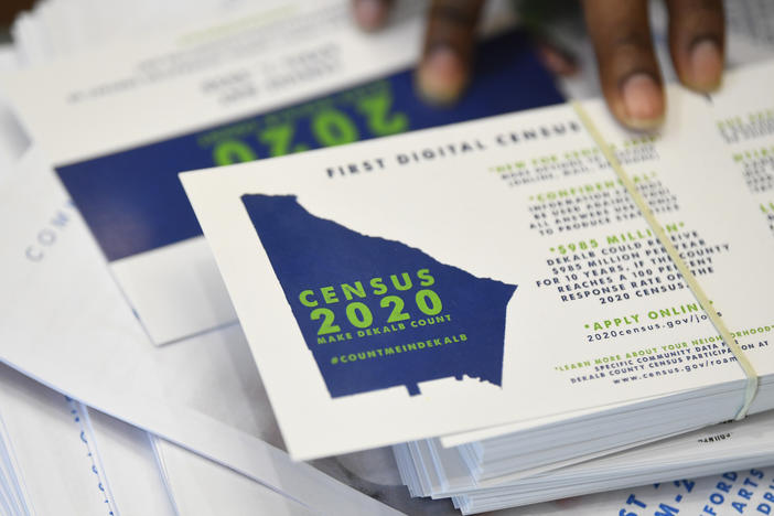 A worker gets ready to pass out instructions on how fill out the 2020 census during an August 2019 town hall meeting in Lithonia, Ga.