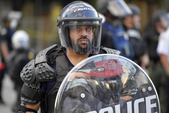 Atlanta Police monitor demonstrators protesting, Friday, May 30, 2020 in Atlanta. The protest started peacefully earlier in the day before demonstrators clashed with police.