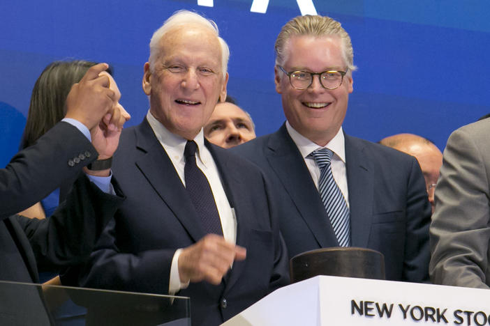 Delta Airlines CEO Ed Bastian, right, accompanied by former CEO Jerry Grinstein, center, wait to ring the closing bell of the New York Stock Exchange, May 3, 2017.