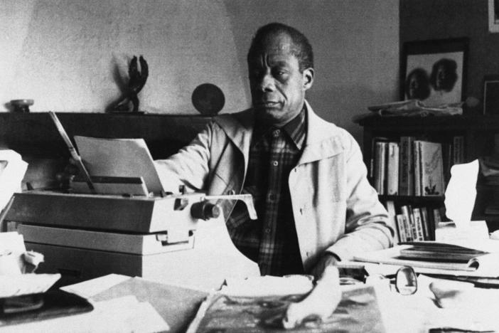 American writer James Baldwin poses in front of his typewriter in his house, March 15, 1983, in Saint Paul de Vence, France.