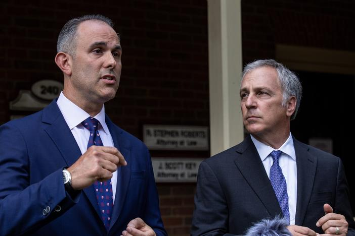 Attorney Jason Sheffield (left) and his law firm partner, Robert Rubin, respond to questions from the press outside their office on Thursday, May 14, 2020, in Decatur, Georgia.