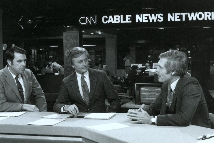 Ted Turner speaks with anchors before a CNN newscast.
