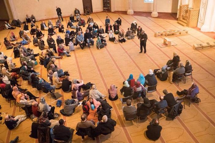 "People gathered at Al-Farooq Masjid for a ""Vist a Mosque"" event hosted by the Islamic Speakers Bureau of Atlanta."