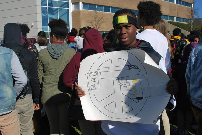 Rashawn Collins, a student at Maynard Holbrook Jackson High School in Atlanta, protests gun violence after walking out of school with hundreds of classmates.