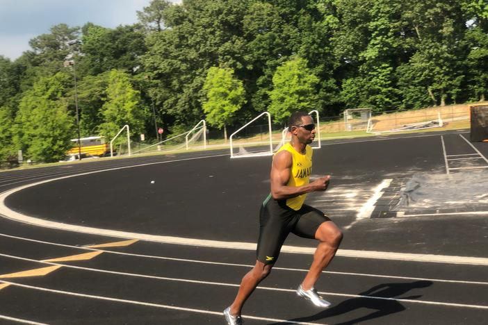 Sprinter Durran Dunn warming up on track field in Smyrna.