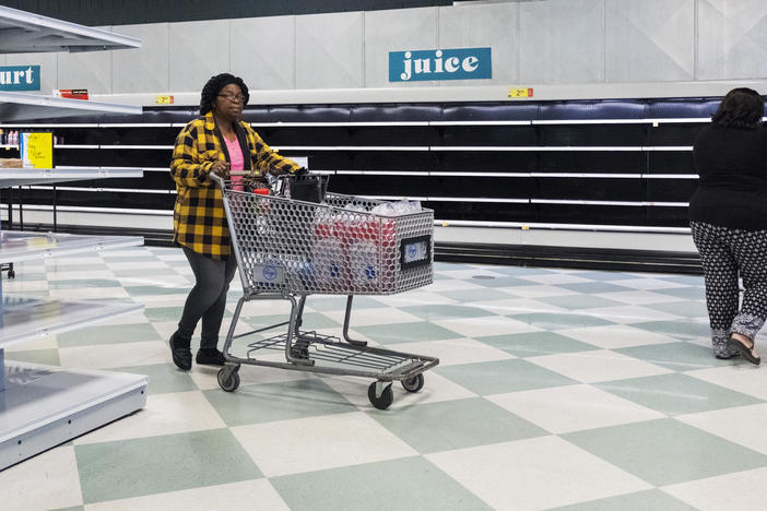 Emptied out refrigerated shelves in the Kroger store on Pio Nono Avenue in Macon on its last day of operation, April 20.
